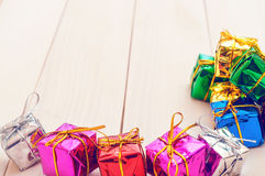 Boxes with gifts on a light wooden boards Royalty Free Stock Photos
