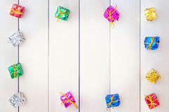 Boxes with gifts on a light wooden boards Royalty Free Stock Images