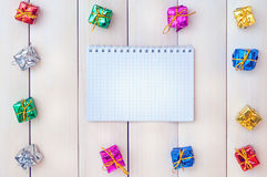 Boxes with gifts on a light wooden boards Stock Images
