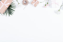 Boxes with gifts, ribbons, rope and flowers on white table, top Royalty Free Stock Images