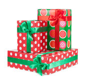 Boxes with gifts tied with red ribbon and bows isolated Royalty Free Stock Photo