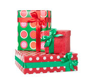 Boxes with gifts tied with red ribbon and bows isolated on white. Background Royalty Free Stock Photo