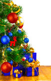 Boxes with gifts under the Christmas tree Stock Images