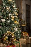 Boxes with gifts under the Christmas tree, Christmas decor, Christmas tree decorated with gold and white balls royalty free stock images