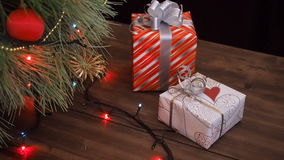 Boxes of gifts are under the tree. Gifts are Packed in colorful paper and tied with string and ribbons. Christmas. Gifts boxes under the tree. Gifts are Packed stock footage