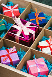 Boxes with gifts in a wooden box Royalty Free Stock Photography