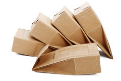 Boxes from the goffered cardboard isolated Stock Photos