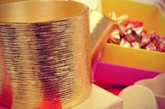 Boxes, golden ribbons and ribbon bows Stock Photo