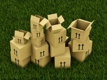 Boxes on grass Royalty Free Stock Photo