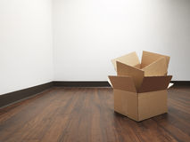 Boxes for house move empty room - Stock Image Stock Image