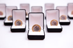 Boxes of jewels with coin Royalty Free Stock Photos