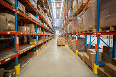 Boxes kept on shelves in the warehouse Royalty Free Stock Photo