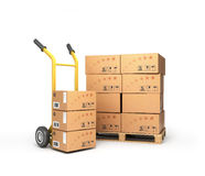 Boxes lie on a pallet near the handcart Stock Photography