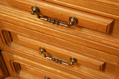 Boxes of a locker. A locker from a tree, with carved incrustation and iron handles Royalty Free Stock Image