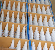 Boxes with many jars with the White Cap Royalty Free Stock Photography
