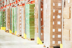 Boxes in modern storehouse royalty free stock photography