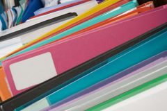 Boxes of multi-colored folders. College projects in boxes. File sticking out ready for your own text Royalty Free Stock Images