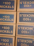 Boxes of nickels. One hundred dollar Boxes of united states coins, nickels stock photos