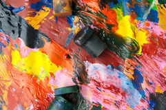 Boxes and oil paints multicolored closeup abstract background from above Stock Photography