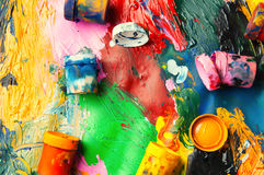 Boxes and oil paints multicolored closeup abstract background fr Stock Images