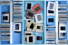 Boxes with old dusty slides. Blue boxes with old dusty negatives and slides background Stock Photo