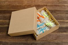 Boxes with packaged sweets. Bars. Wooden table. Place for text.  Royalty Free Stock Photography
