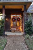 Shipping packages on porch during holiday season stock photography