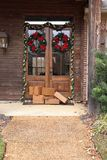 Packages on porch during holiday season stock photography