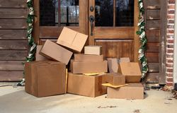 Boxes on front porch during holiday shopping season royalty free stock images