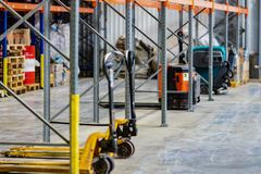 Boxes and pallet truck in the old warehouse.Blurred background warehouse stock image