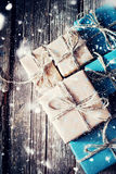 Boxes in Paper with Linen Cord. Effect Drawn Snow Stock Photo