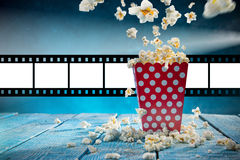 Boxes of popcorn on blue background. Stock Photography