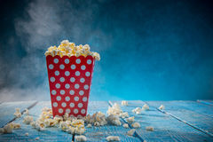 Boxes of popcorn on blue background. Stock Image