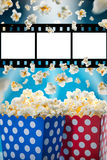 Boxes of popcorn on blue background. Stock Photo