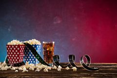 Boxes of popcorn on blue and red background. Boxes of popcorn on blue and red background, close-up Royalty Free Stock Photography