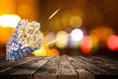 Boxes of popcorn on old wooden table. Stock Images