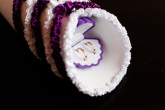 Boxes for purple petals on a black table with wedding rings Stock Image