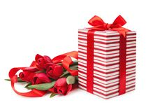 Boxes with red ribbons and a bouquet of tulips isolated Royalty Free Stock Photography