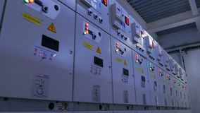 Boxes row of electrical appliances with illuminated buttons. Closeup gray boxes row of electrical appliances with illuminated button dashboards and danger signs stock footage
