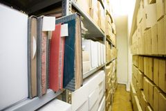 Boxes on the shelf. Brown and white boxes on the shelf royalty free stock image