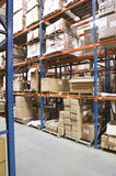 Boxes On Shelves In Warehouse Royalty Free Stock Photo