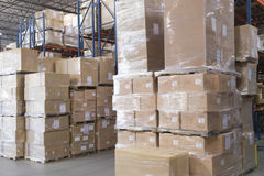 Boxes Stacked In Warehouse Stock Images