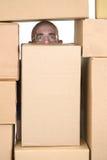 boxes stockmanen för pappmanmaterielet Royaltyfri Foto