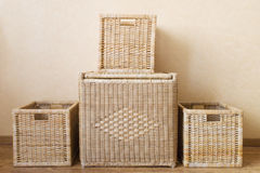 Boxes for storage. Four wicker boxes of different size Stock Photos
