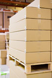 Boxes in storage warehouse Royalty Free Stock Images