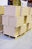 Boxes in storage warehouse Stock Photography