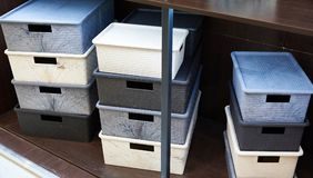 Boxes for storing household items in store Stock Photos