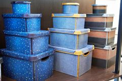 Boxes for storing household items in store. Beautiful boxes for storing household items on the shelf in the store Stock Image