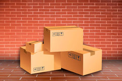 boxes tegelstenväggen royaltyfria bilder