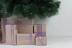 Boxes tied with ribbons under the green branches Royalty Free Stock Photography